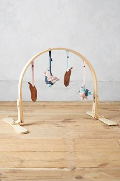 Finn + Emma Critter Play Gym // wooden play gym for babies