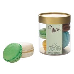 Brides.com: Style Inspiration: Children's Books. Hand out containers of colorful macarons as a sweet nod to the book's Parisian setting. Macarons, $45 for 24, Macaron Café; Cityscape stamp set, $30, Yellow Owl Workshop