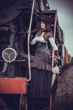Sophisticated Steampunk Style (striped trumpet skirt, blouse, underbust corset, bolero jacket, parasol, top hat, choker)  - For costume tutorials, clothing guide, fashion inspiration photo gallery, calendar of Steampunk events, & more, visit SteampunkFashionGuide.com