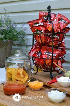 "Consider a ""walking taco"" bar. Small bags of doritos and the fixings for tacos. Easy, buffet-style meal... and when you put the taco meat in a crock pot, you can leave this one set up all day long! #CreativeMemories #NSD2015"
