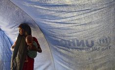 A Somali refugee stands inside a tent with her baby in Dollo Ado, Ethiopia. UN Photo/Eskinder Debebe. Un Refugee, Refugee Crisis, Refugee Camps, Somali Refugees, Across The Border, Ethiopia, Human Rights, South Africa, Tent