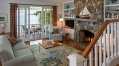 built-ins on each side of fireplace, Spruce Point Cottage, Boothbay Harbor, Maine | Whitten Architects