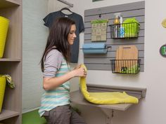 The laundry room also features a flip-up folding table. If you make your own, a comfortable height for a folding surface is between 29-33 inches.