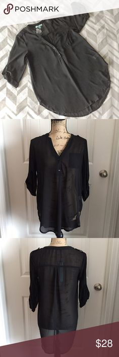 Sheer Black Roll-up Sleeve Top She + Sky  Work Blouse? Casual Day-Out Blouse? Either way this Blouse looks ahhhhhhmazing on! It features buttons in the front, on the shoulder and for rolling the sleeves, and a pocket on the front left side. The back is longer than the front and covers the bum. It's sheer, so wear a shirt underneath or sport with a beautiful bandeau or bralette! Fits true to size! She and Sky Tops Blouses