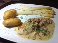 A typical German dish: May plaice, potatoes, white asparagus and a sauce with brown shrimps from the North Sea, dill and mustard. Together with a German white wine: Heaven!