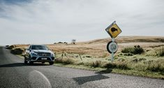 Front view of the Mercedes-Benz GLE on a road in New Zealand.