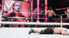 WWE The Authority: Mr Money in the Bank Seth Rollins, Kane & Big Show with Jamie Noble & Joey Mercury vs John Cena, 3-on-1 Handicap Match. Sting