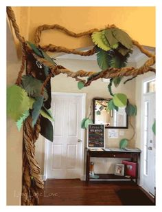 PERFECT paper jungle vine for a born to be wild baby shower or birthday party. Simple and budget friendly DIY party decoration PERFECT paper jungle vine for a born to be wild baby shower or birthday party. Simple and budget friendly DIY party decoration Kindergarten Party, Festa Jurassic Park, Dinosaur First Birthday, Deco Jungle, Jungle Safari, Jungle Lion, 3rd Birthday Parties, 4th Birthday, Safari Birthday Party