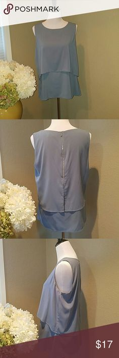 Calvin Klein camisole top Just in time for spring! This top has only been worn a few times and is in excellent condition. Calvin Klein Tops Camisoles