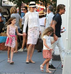 Family outing: Nicole Kidman, 49, and Keith Urban, 48, took daughters Sunday Rose, eight, and Faith Margaret, 5, street vendor shopping on Saturday
