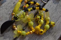 """Collier ethnique """"En jaune d'abeille"""" avec tranche tagua, perles coccinelles en verre filé, perle Lampswork, graines : Collier par les-perles-de-eihpos"""