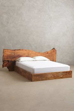 Live Edge Wood Bed - anthropologie.com $3500 (no storage space below)