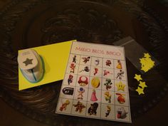 """Super Mario Bros Bingo! punch out stars from card stock to use as """"markers"""" and keep it organized by putting 20 stars in a zip pouch for each player."""