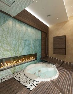 The idea of a sunken tub is interesting/unique and I like the idea of a bathroom fireplace that can be seen from the bedroom and the bath. Not a fan of wall design or this particular execution of the concept though. Zen Bathroom, Master Bathrooms, Luxury Bathrooms, Minimal Bathroom, Bathroom Interior, Modern Bathroom, Small Bathroom, Sunken Bathtub, Jacuzzi Bath
