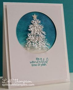 Stamping with Loll: sponged two shades of blue ink for the background and then layered several white pine branches which I had die-cut and painted with some silver glitter to add sparkle.  I framed the tree with a circle die-cut and added a silver glimmer star to the top of the tree. Wreath Strip die (Cheery Lynn)  @(123 Stitch)