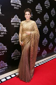 Raveena Tandon glittering in a gold dust saree at the Miss Diva 2013 event. #Bollywood #Fashion #Style
