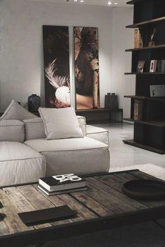 luxe uitstraling gecreëerd met de bank los van de muur én een paar mooie items op de salontafel