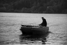 Man on boat, Derwent Water, Keswick, Lake District, Cumbria, 17th Oct 2014