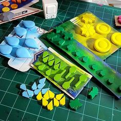 Painting day for Pokeymans badges. Each badge is cast in dyed resin sanded and then airbrushed for the best possible finish. Not that big of a deal for most of them but the Rainbow badge has 9 different individual pieces that have to be finished and assembled.  #pokemon #cosplay #anime #cosplayprop #pokemon20 #resin #smoothon #nintendo #casting #propmaking #propreplica #moldmaking #cast #wip #art #painting #paint #airbrush #airbrushing