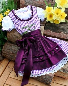 Obligatory clothing für bavarian baby girls: the dirndl. It's just too cute and my favorite color (purple)! Kerstins Landhausmode