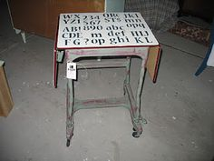 Letters stenciled on vintage typewriter table