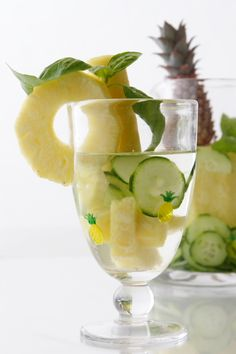 Pineapple Basil Cucumber Infused Spa Water. 1 pineapple cored (we use the vitamin packed core for garnish), 1 half English cucumber thinly sliced, 1 fresh basil stem, 1 Long Stemmed Baby Pineapple (if desired, for garnish), & 4 c ice cold water. Combine ingredients and allow 20 ~ 30 minutes for flavors to infuse. Here, we have also garnished with a Long Stemmed Baby Pineapple we found at Whole Foods Market. Serve chilled and keep refrigerated.