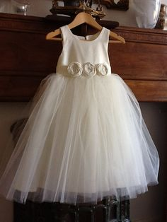 Flower girl dress , cotton, silk or satin with 3 layers of soft tulle over skirt. $110.00, via Etsy.