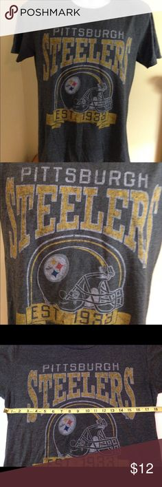 "Pittsburg Steelers Ladies Tshirt Sz M Pittsburg Steelers Ladies Tshirt Sz M in great preowned condition. Armpit to armpit 18"", no flaws.Dark gray short sleeve. NFL Tops Tees - Short Sleeve"