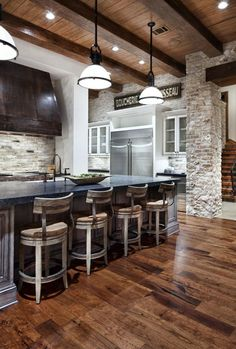 Love this kitchen's use of whites and woods- Nice color in brick to tie it together!