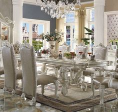 Versailles Bone White Dining Table 61130 Description: Irresistibly inviting, the Versailles collection displays the unrivaled beauty of the traditional dining. The dining table reflects highly decorat