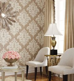 Wallpaper adds to this neutral color room.