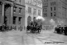 One of the last horse-drawn fire engines  Company 205 of the New York Fire Department, races along a city street.  December 27, 1922.  shared by www.nyfirestore.com