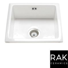 Depending on the model of the plumbing kit, it also has spigots available to take appliance waste away, such as washing machines or dishwashers). White Ceramic Kitchen Sink, Kitchen And Bath, New Kitchen, Kitchen White, Awesome Kitchen, Kitchen Ideas, Martha Stewart, Ceramic Undermount Sink, How To Wash Vegetables