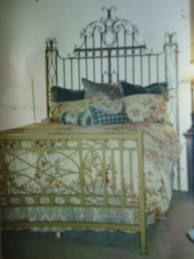 Perfect!!!a vintage iron gate used as a headboard...love it..definatly will suggest to my clients.