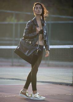 Motorcycle Jacket: Schott Perfecto  Leather Weekender Bag: Simone Michele Sports Bra: Nike Running Tights: Nike Sneakers: Nike