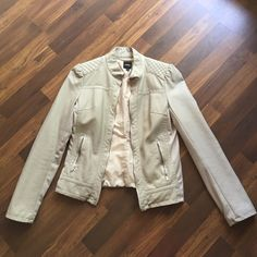 Express faux leather Moto jacket Cream faux leather jacket with fuchsia sleeve lining. Lightly used condition. Only imperfection is one light pen mark on back of sleeve as shown and slight pilling of cotton trim on sleeves/sides of jacket but not super noticeable. Express Jackets & Coats
