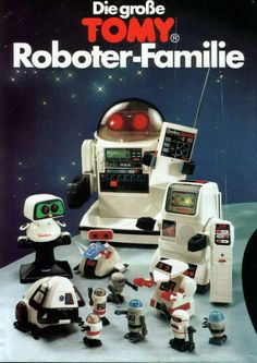 I remember the commercial for a very large robot that would carry a can of pop to someone. I totally begged for that one. Alas, I did not receive, but I did get the one in this photo, lower right with the red hands. He did flips. ;) lol