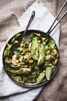 Brussel sprouts with avocado and lime. Add chopped, toasted pine nuts, extra garlic, dash of herb, and slightly fry the avocado before adding.