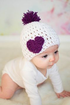This baby is so precious, she isn't real!!! Look at that cute heart crochet hat she's wearing