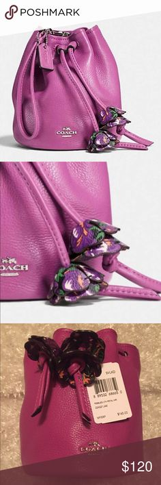 """Spring is here with this beautiful COACH wristlet Petal COACH wristlet in beautiful Hyacinth (light purple) pebbled leather with leather drawstring closure with flower details. Lining is fabric. Dimensions are 5 1/4"""" L and 5 3/4"""" H. Wrist strap and COACH tag attached. Unique round wristlet gives extra flirty style and more room. Will arrive completely sealed in all COACH packaging. Brand New With Tags. Coach Bags Clutches & Wristlets"""