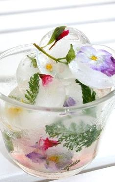 Such a pretty idea! Use boiled and cooled water for sparkling clear water. Freeze a little water in the ice cube tray, add edible flowers or fruit and a little more water and freeze again. Top up with water and freeze for the final time!