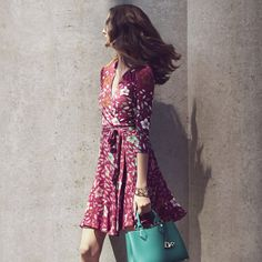 Ready in a flash: the floral Irina Wrap Dress and bright teal Voyage Tote are an indispensable pair. http://on.dvf.com/1DVIK0t #ootd