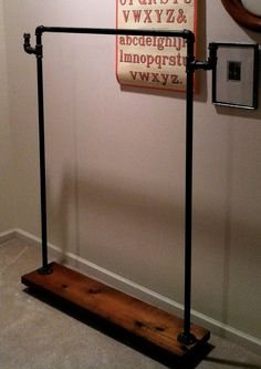 """Industrial Garment Rack with Hooks (42"""").  I like this so you can hang next day's outfit on the ends!"""