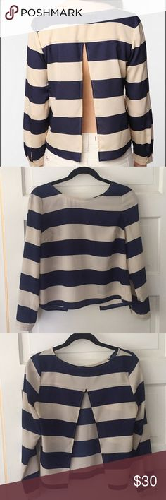 Urban outfitters Cope white and navy backless top Urban outfitters cope clothing navy and white long sleeve striped top with slit in back. Worn gently. Urban Outfitters Tops Blouses