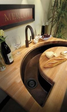 kitchen prep sink with cutting board in front of it. dream kitchen