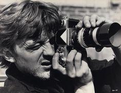 David Hemmings (Thomas) with Nikon F camera