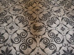 My fantasy library would be covered in sound-dampening carpeting patterned after Ancient Roman mosaic motifs.