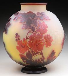 "LARGE GALLE CAMEO GLASS VASE. Large Galle cameo glass vase has round body and is decorated with red cameo roses, stems and leaves all set against a pastel yellow shading to cream background. The foot and lip are finished in deep red. Signed on the side in cameo with an oriental influence signature ""Galle""."