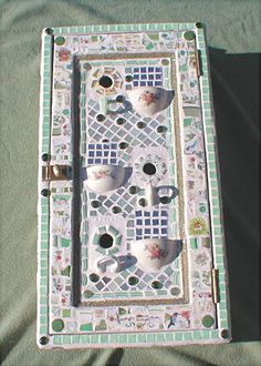 Three foot tall old medicine cabinet made into a mosaic birdhouse . . . very nice...great idea! . . .