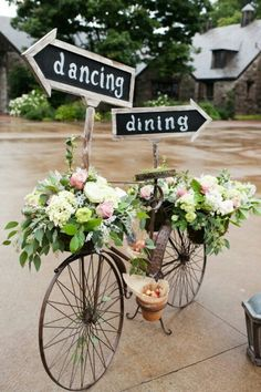 Have an old bike with a basket with a bouquet in them. Have a sign pointing to the entry